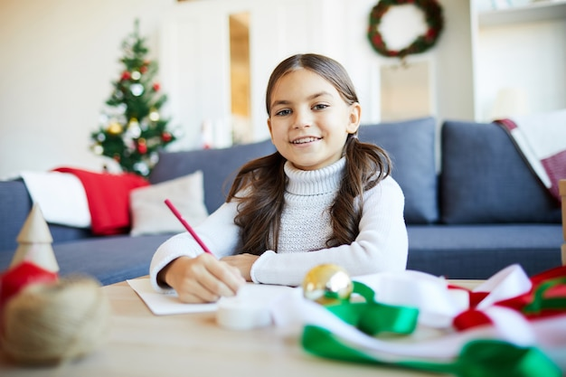 Girl writing a letter for santa