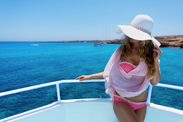 Girl on a yacht. woman enjoying a sunny summer day on a boat. blue lagoon, protaras (paralimni) cyprus