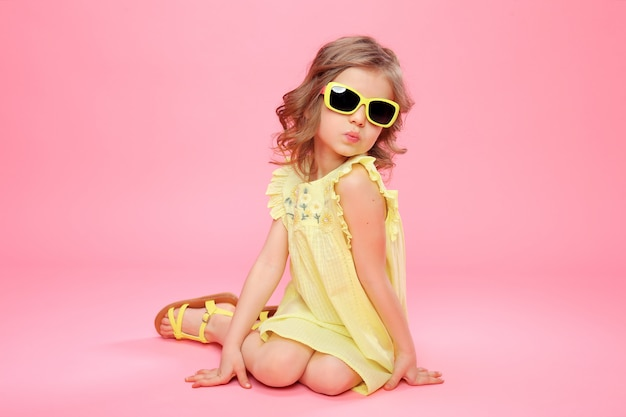 Girl in yellow dress and sunglasses