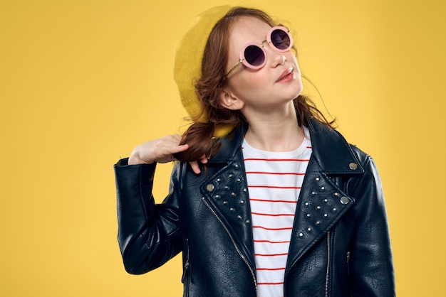 Girl in a yellow hat dark glasses fashionable clothes