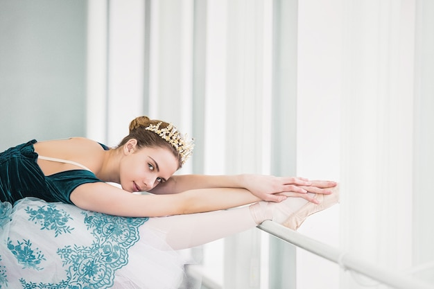 Girl young beautiful dancer teen ballerina in studio trains and rehearses before the performance