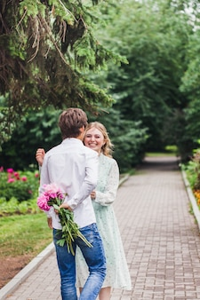 Girl and young man, date, communication, gift, smile, first kiss, family, meeting friends