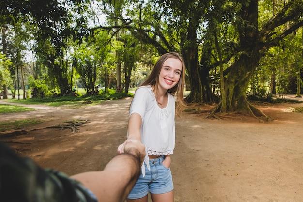 Girlfriend pulling boyfriend