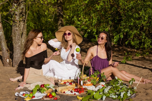 Girlfriends celebrate in the summer at a picnic