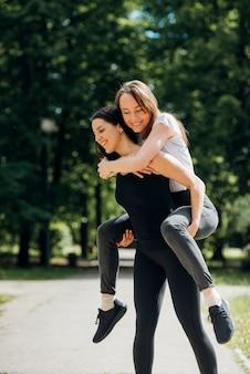 Girlfriends enjoying spending time in park