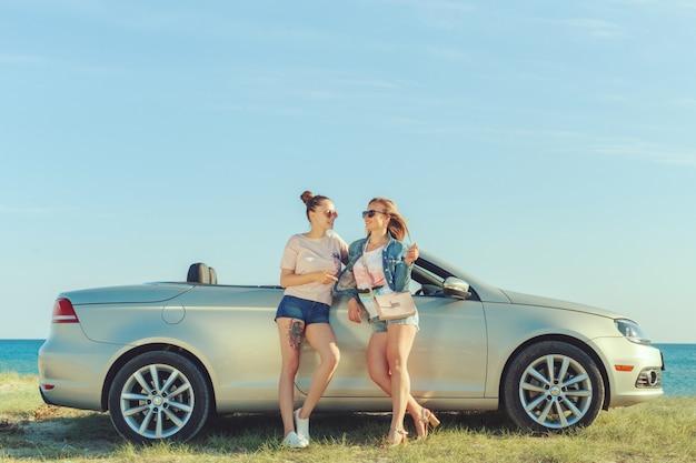 Girlfriends having fun in a convertible