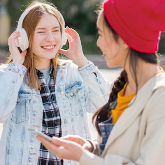Girlfriends listening music