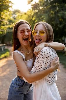 Girlfriends outdoor hugging