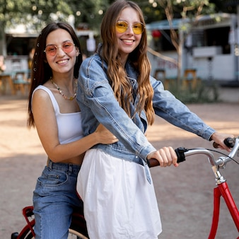 Girlfriends riding bike together
