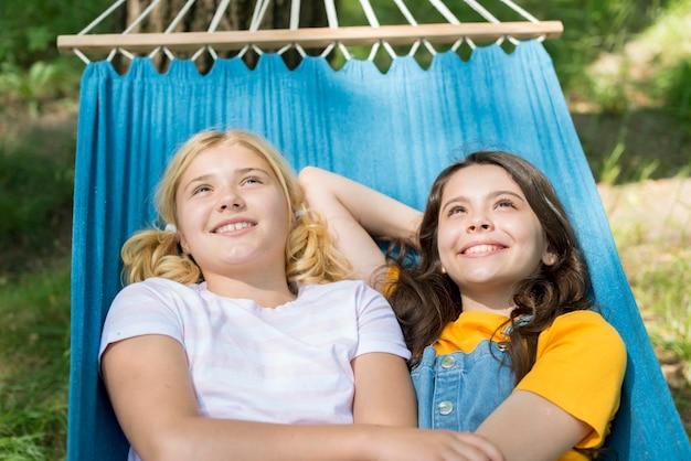 Girlfriends sitting in hammock