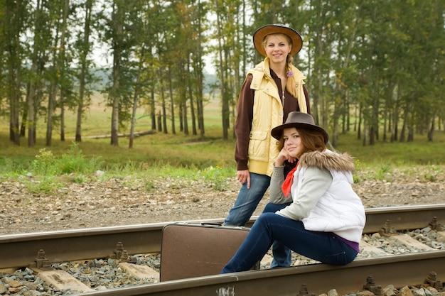 Girls along  railroad rail