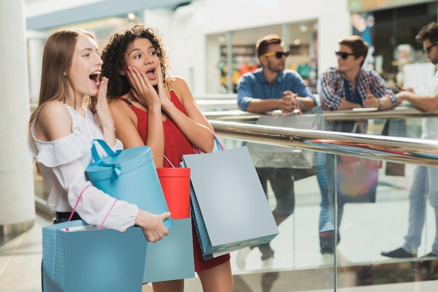 Girls are shopping at the mall. black friday sale.