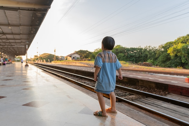 Girls and boys stand for thai train