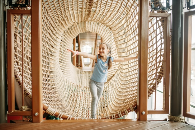 Girls climbing the rope net, children game center