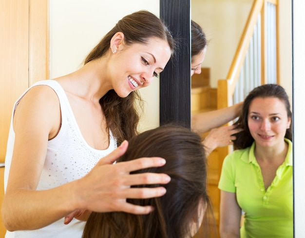 Girls combing the hair