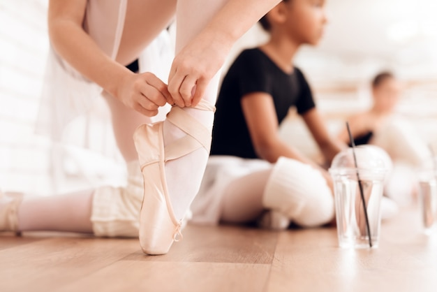 The girls communicate with each other at the ballet school.