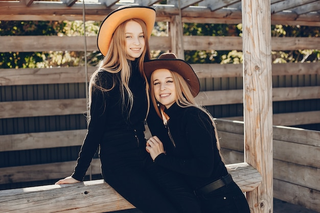 Girls in a cowboys hat on a ranch