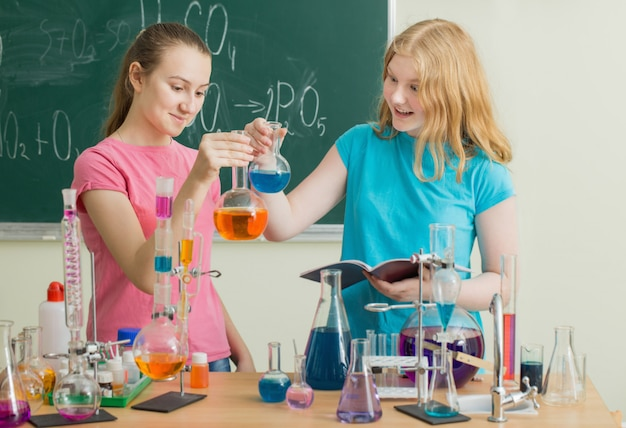 Girls doing chemical experiments
