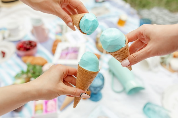 Girls eat ice cream at a summer picnic