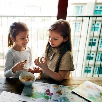 Girls eating cookies snack concept