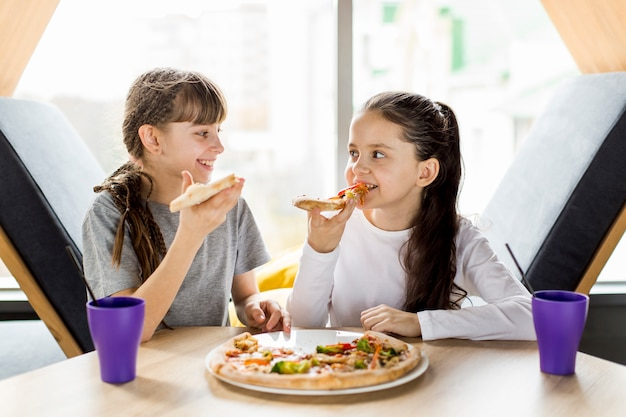 Girls eating pizza