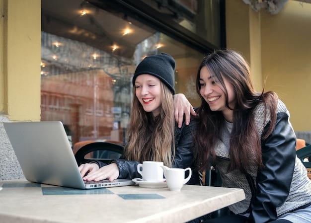 Girls having fun in a coffee shop