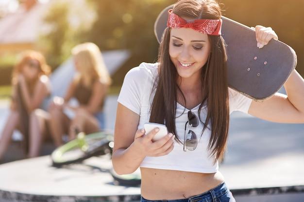 Girls having fun in skatepark