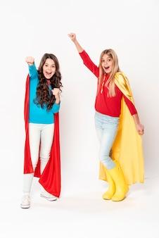 Girls having fun while wearing hero costume