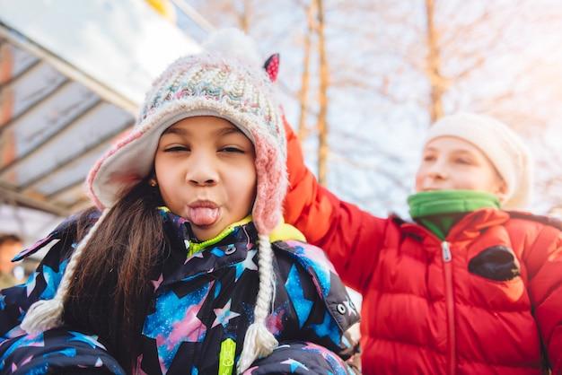 Girls having fun in winter