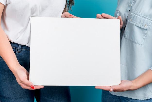Girls holding blank board