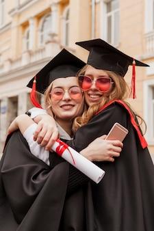 Girls hugging at graduation