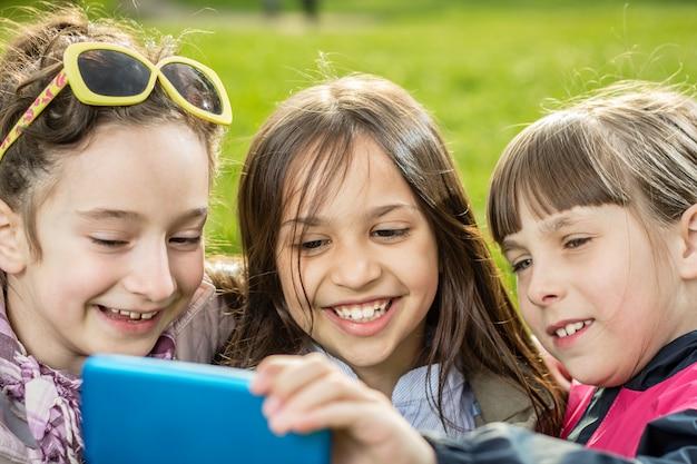 Girls making selfie outdoor