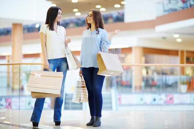 Girls in modern shopping center