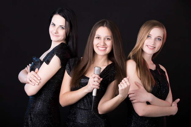 Girls music band with microphone