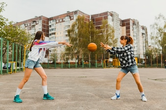 Girls passing basketball
