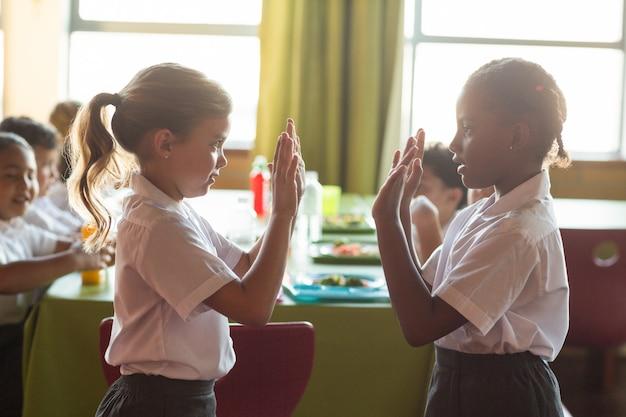 Girls playing clapping game