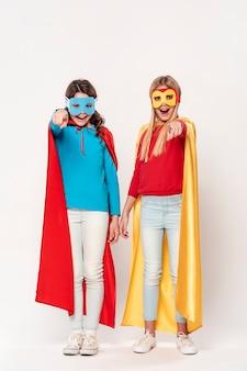 Girls playing superheroes