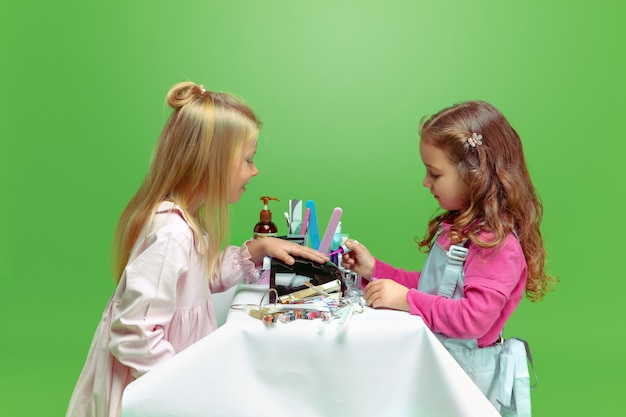 Girls playing with cosmetic products