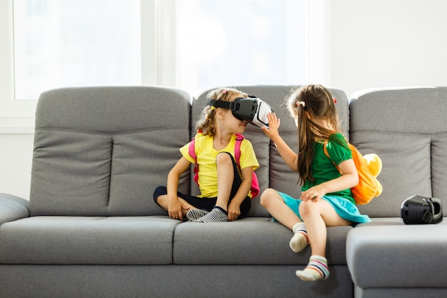 Girls playing with virtual reality goggles