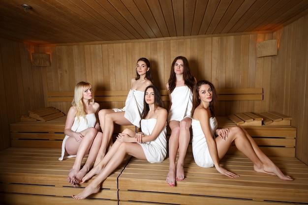 Girls relaxing in the sauna