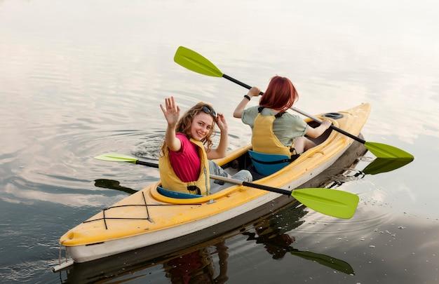 Girls rowing in kayak