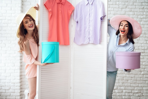 Girls in the showroom. girls have fun in the fitting room.