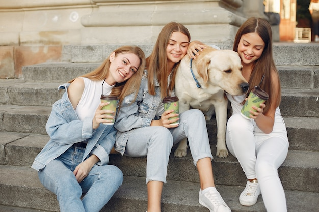 Girls sitting on a staircase with cute dog