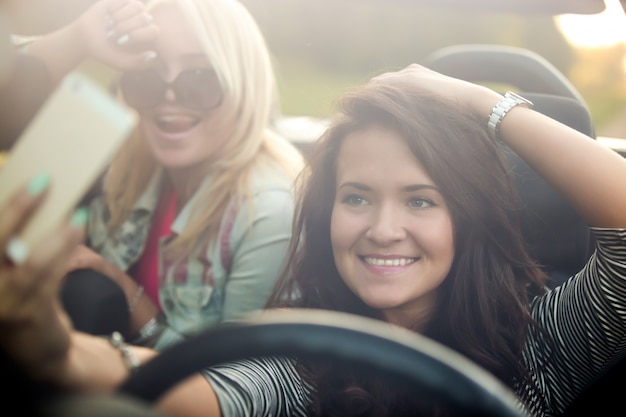 Girls smiling in a car