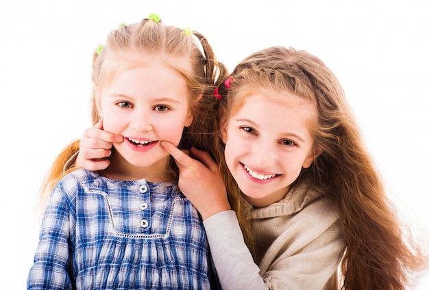 Girls smiling and relaxing together isolated on white background