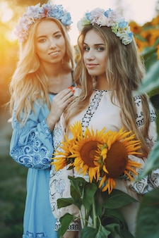 Girls and sunflowers