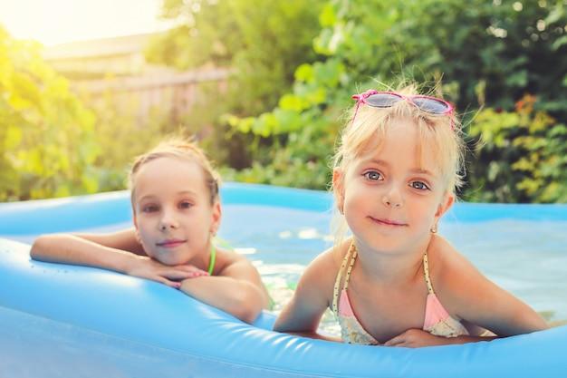 Girls swimming in the pool