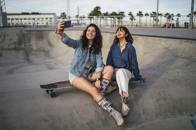 Girls taking a photo of themselves in a skate park