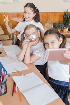 Girls taking selfie at school