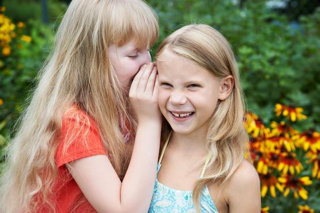 Girls tell each other secrets